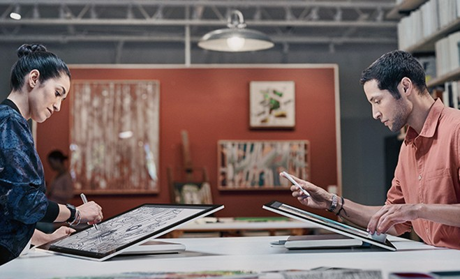 Microsoft Surface Studio all-in-one-workstation being used by designers at design agency.