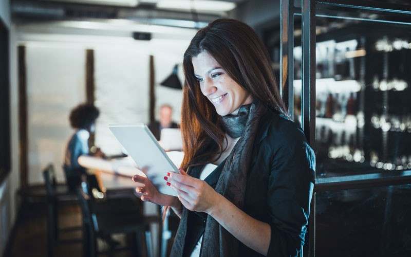 Businesswoman on tablet device in office