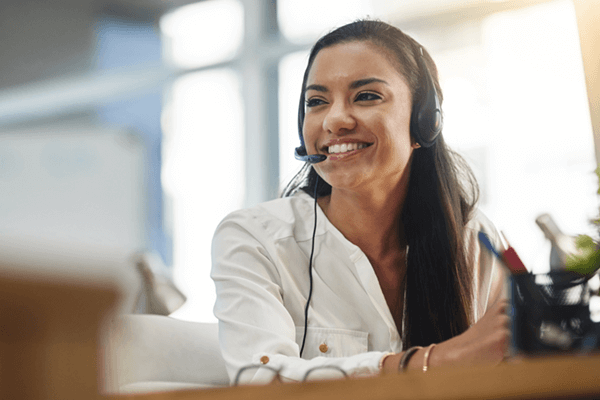 Smiling call center representative ready to help monitor and support your business